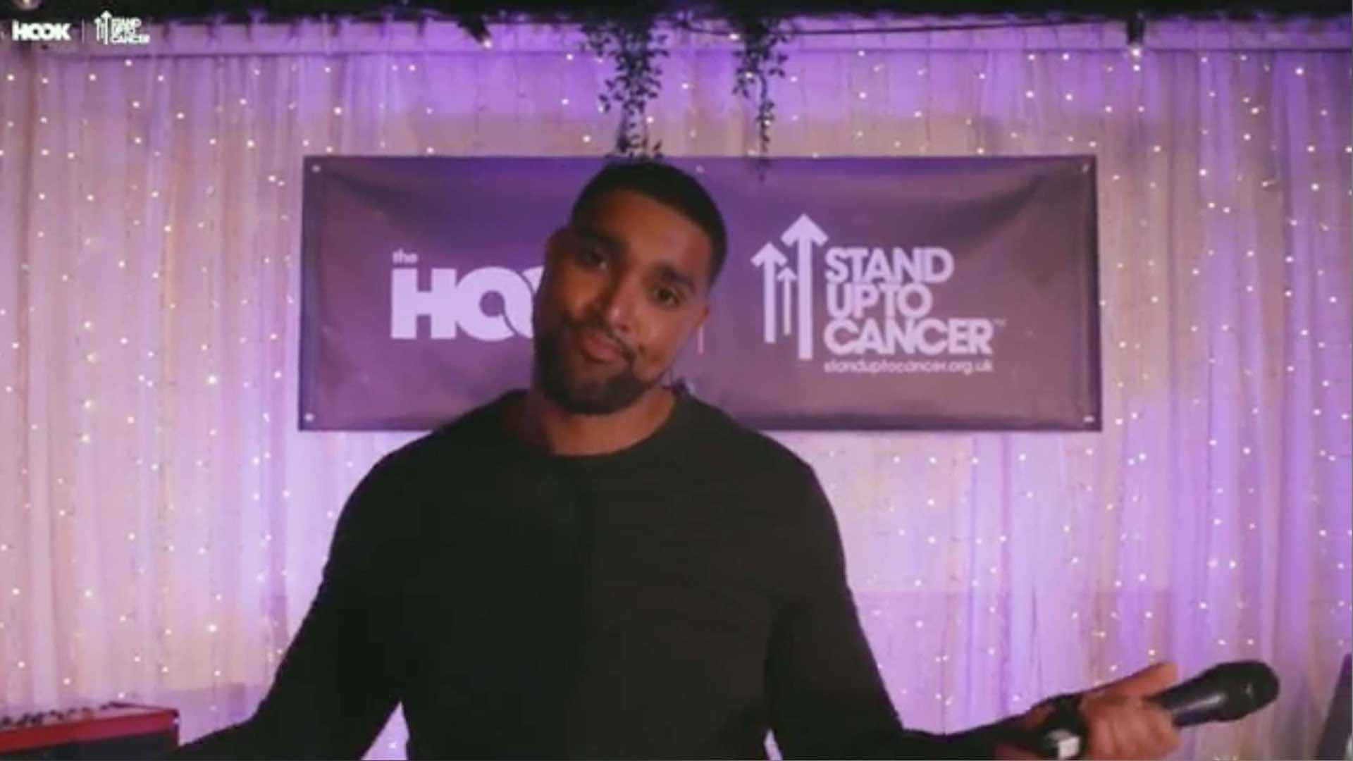 Marcus Bronzy Presenting at the hook x stand up to cancer