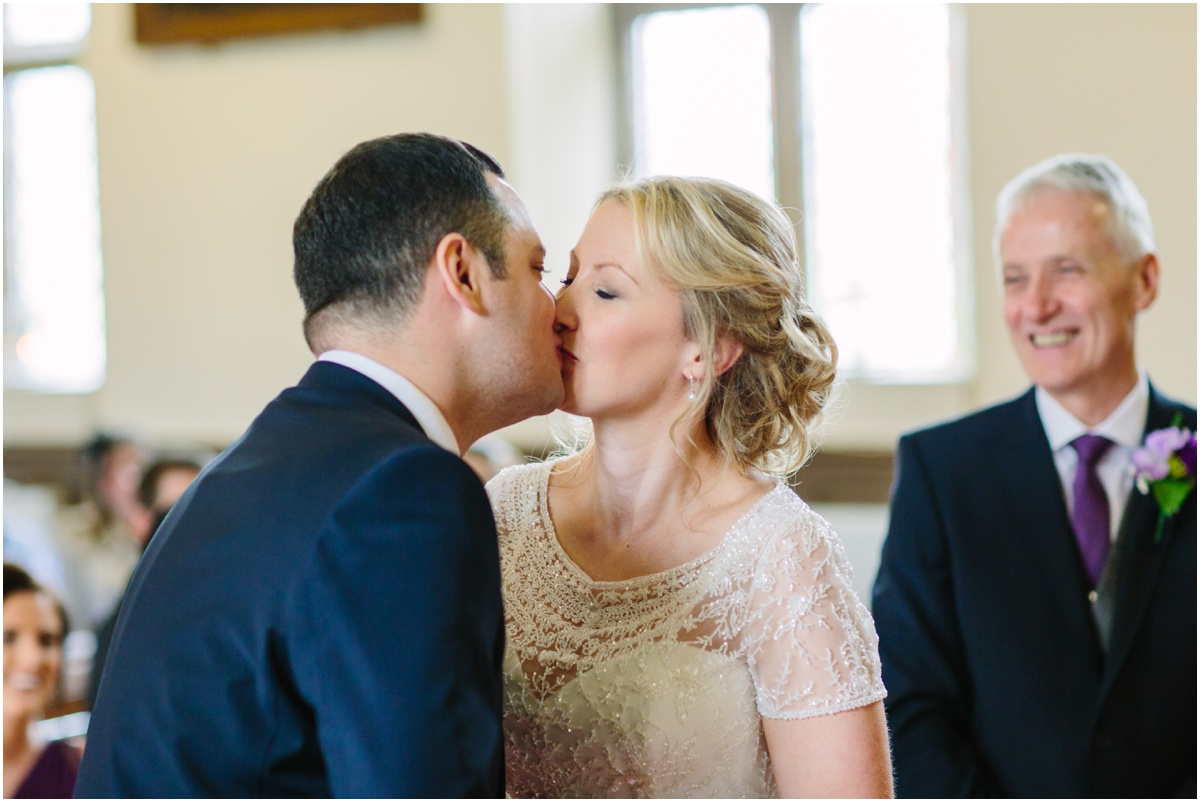 Bride and groom kissing in the church Lancashire wedding