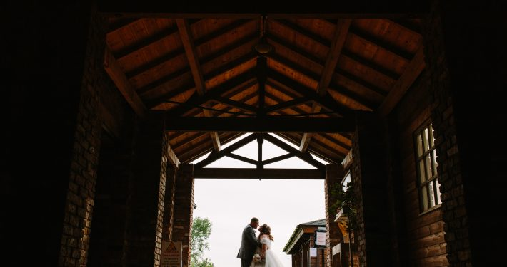 bride and groom kissing in charnock farm lancashire photography venue