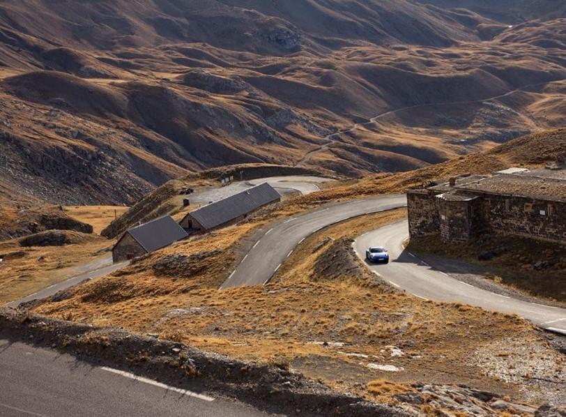 Porsche driving up the Col de la Bonette