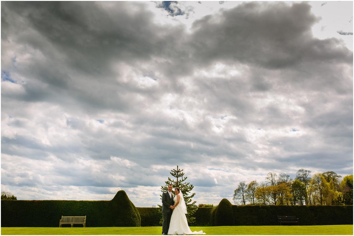 bride and groom in newcastle wedding venue gardens