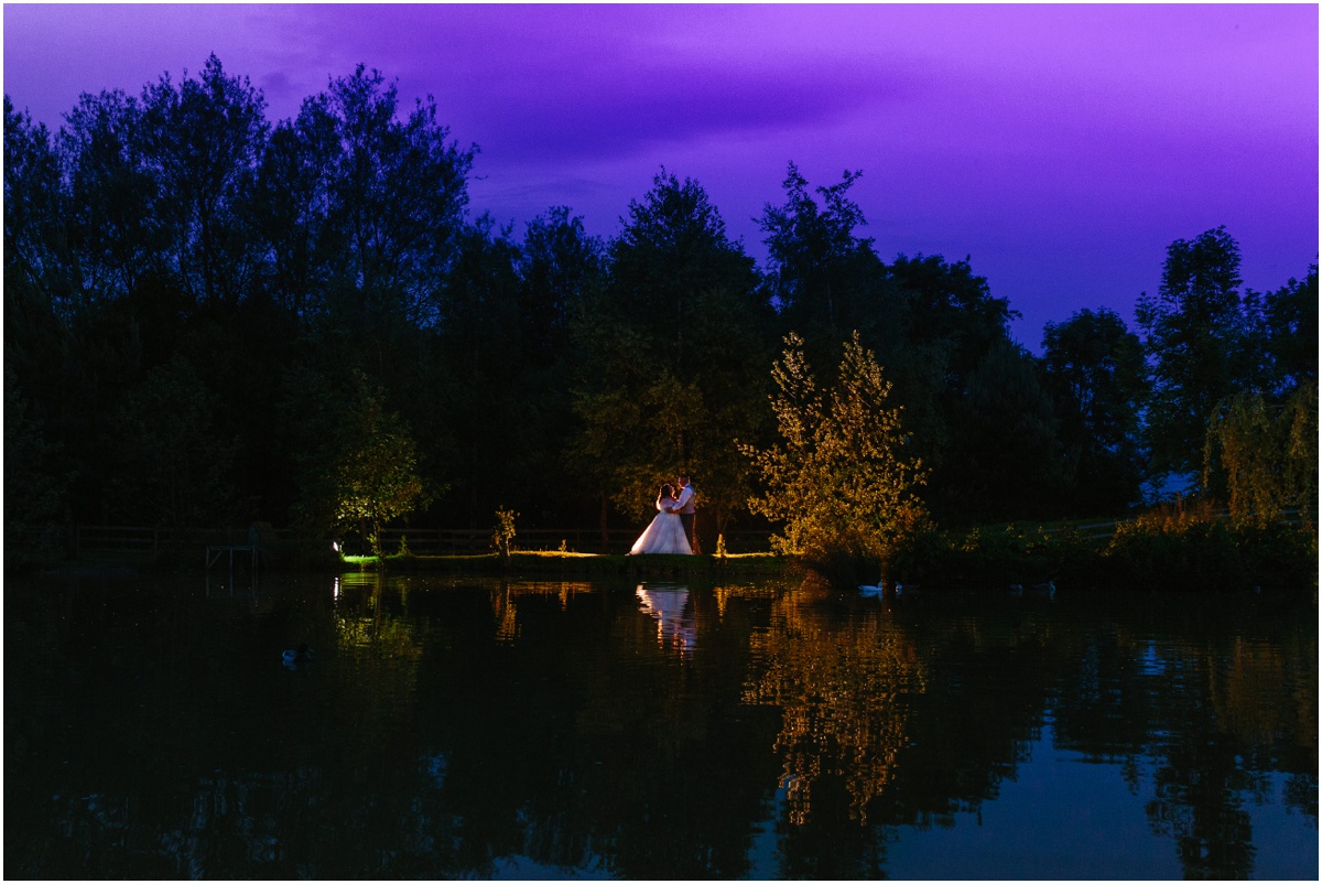 bride and groom next to the lake Lancashire wedding photography wedding by kyle