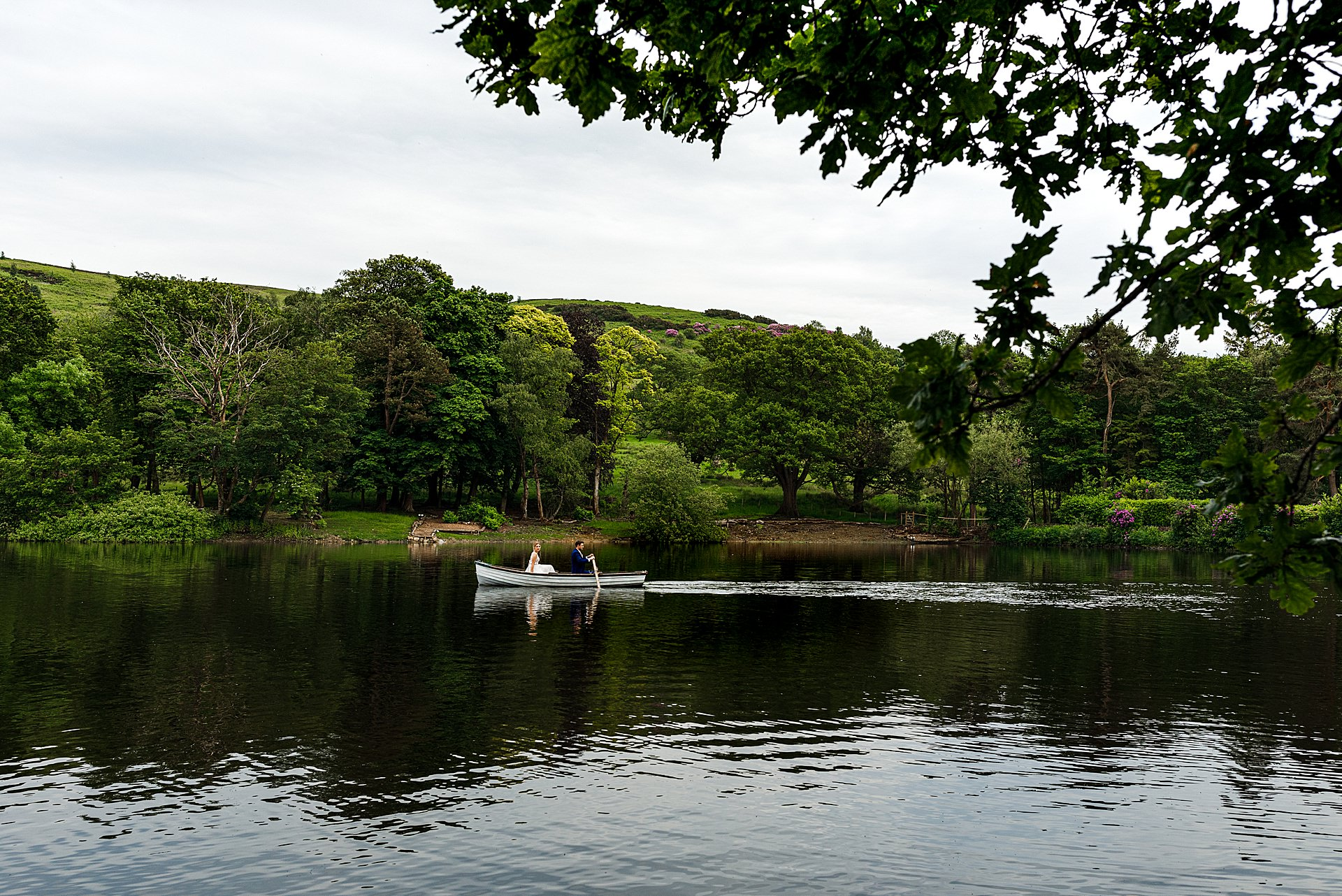 Whyresdale Park lancashire wedding venue bride and groom on the lake photography