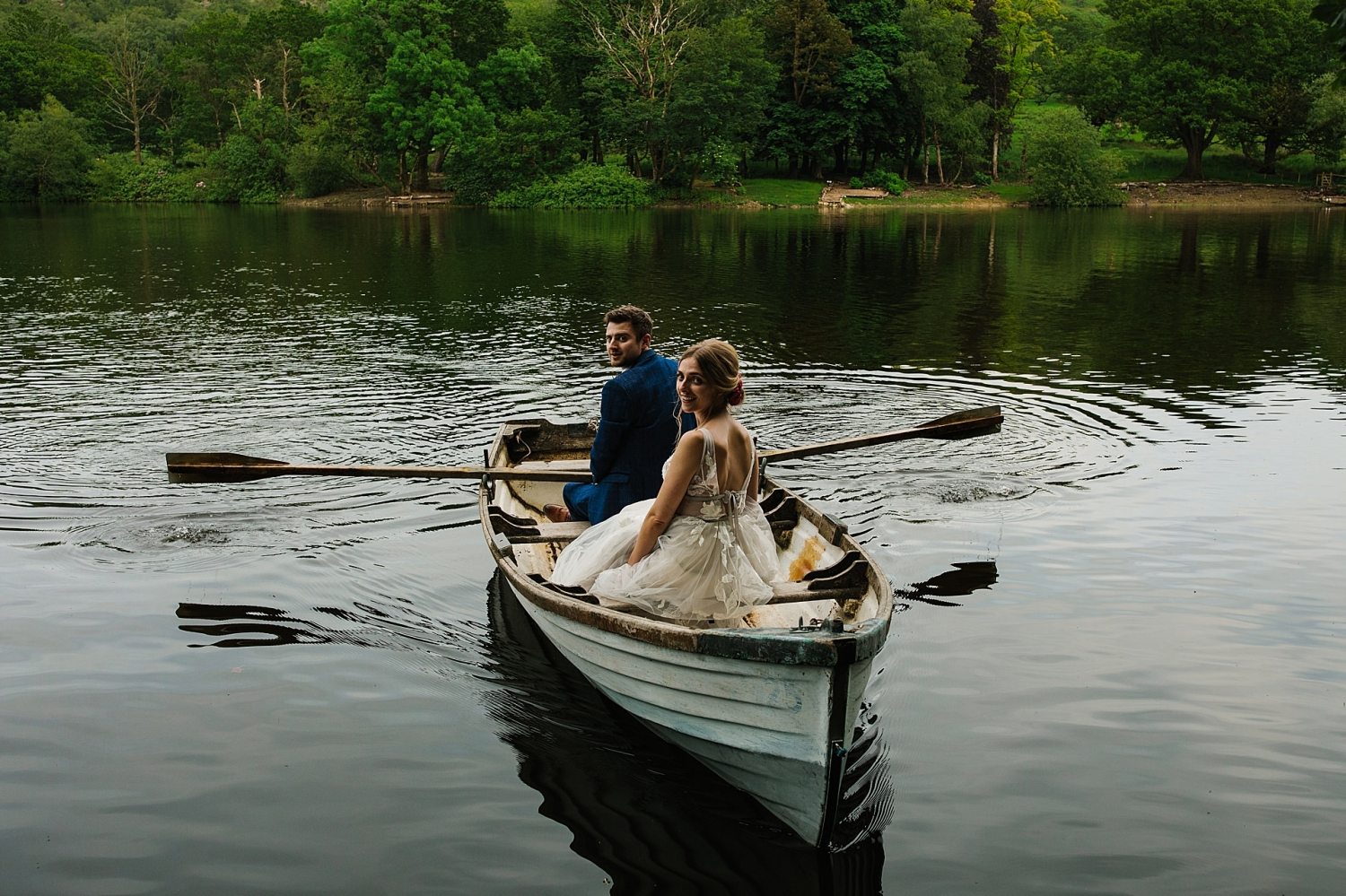 Whyresdale Park lancashire wedding venue bride and groom . on the lake photography
