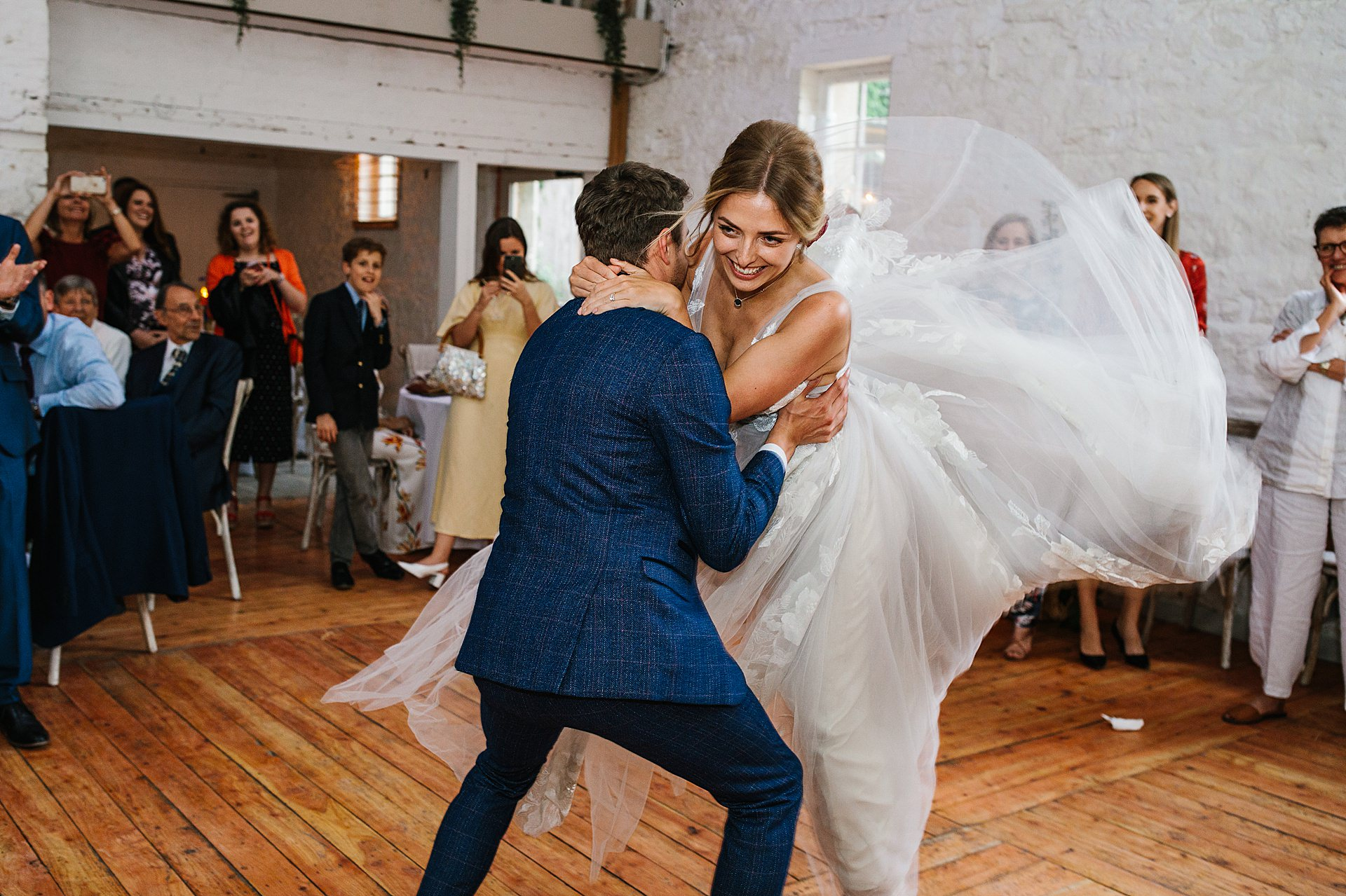 Birdes and Brides maids dancing at the wedding photography