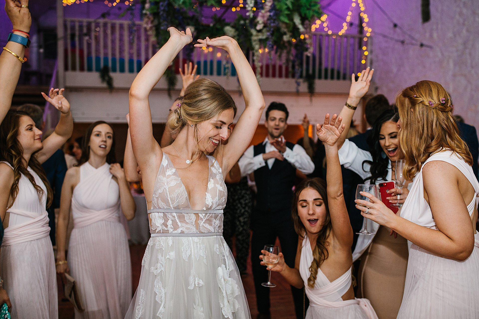 Birdes and Brides maids dancing at the wedding photograpy