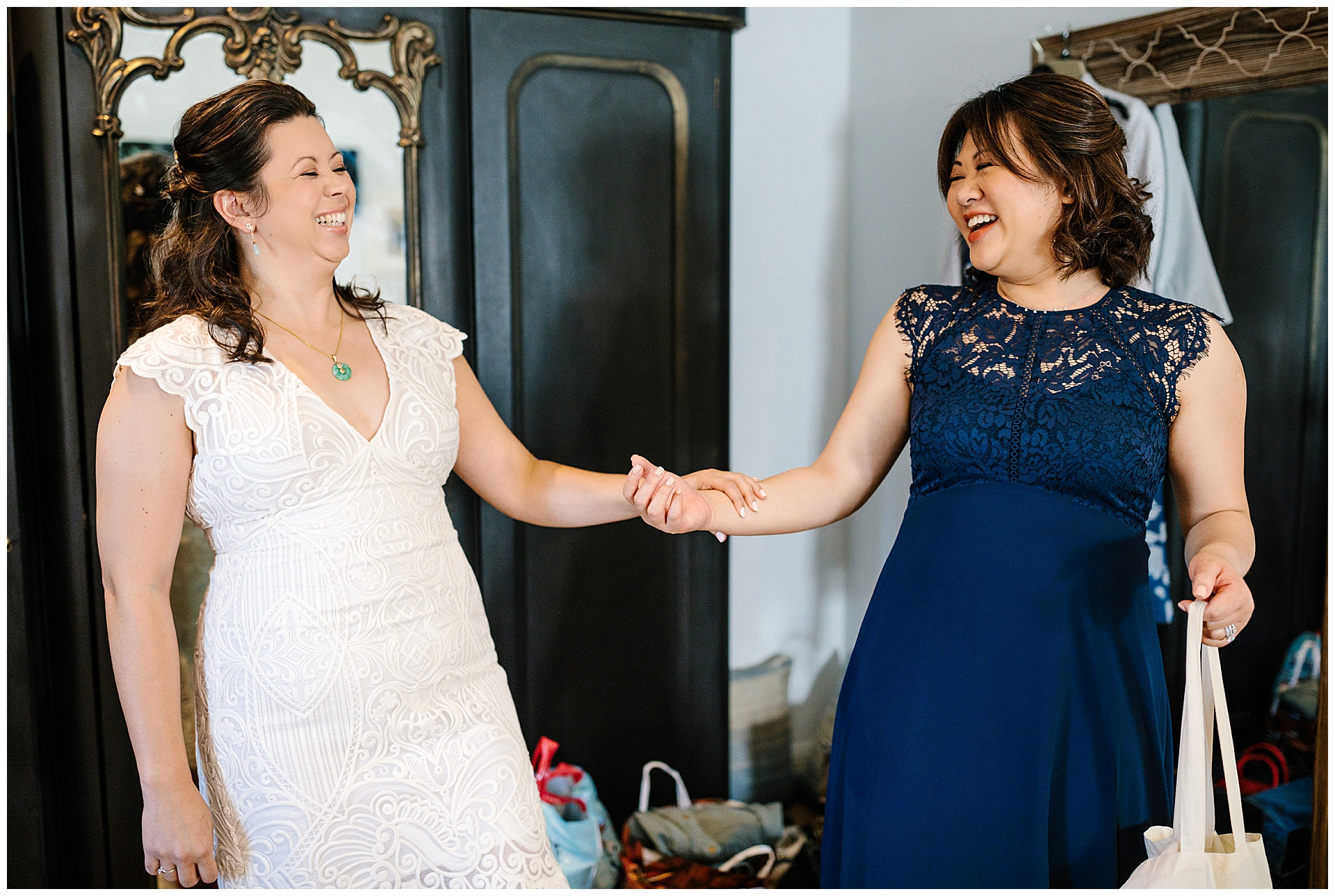 Bride and Bridesmaid laughing in the award winning wedding venue ribble valley