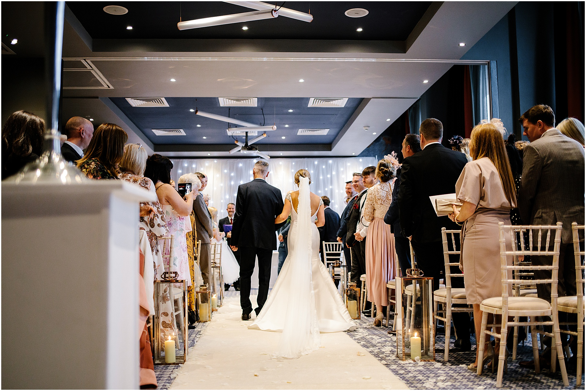 bride walking with father in hand liverpool wedding venue
